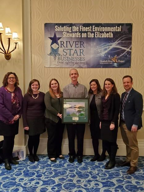 Photo of sevent HRPDC employees accepting a photo of the Elizabeth River from the Elizabeth River Project in recogition of the HRPDC's efforts toward sustainable practices in pollution prevention, wildlife habitat enhancement and community outreach and education.