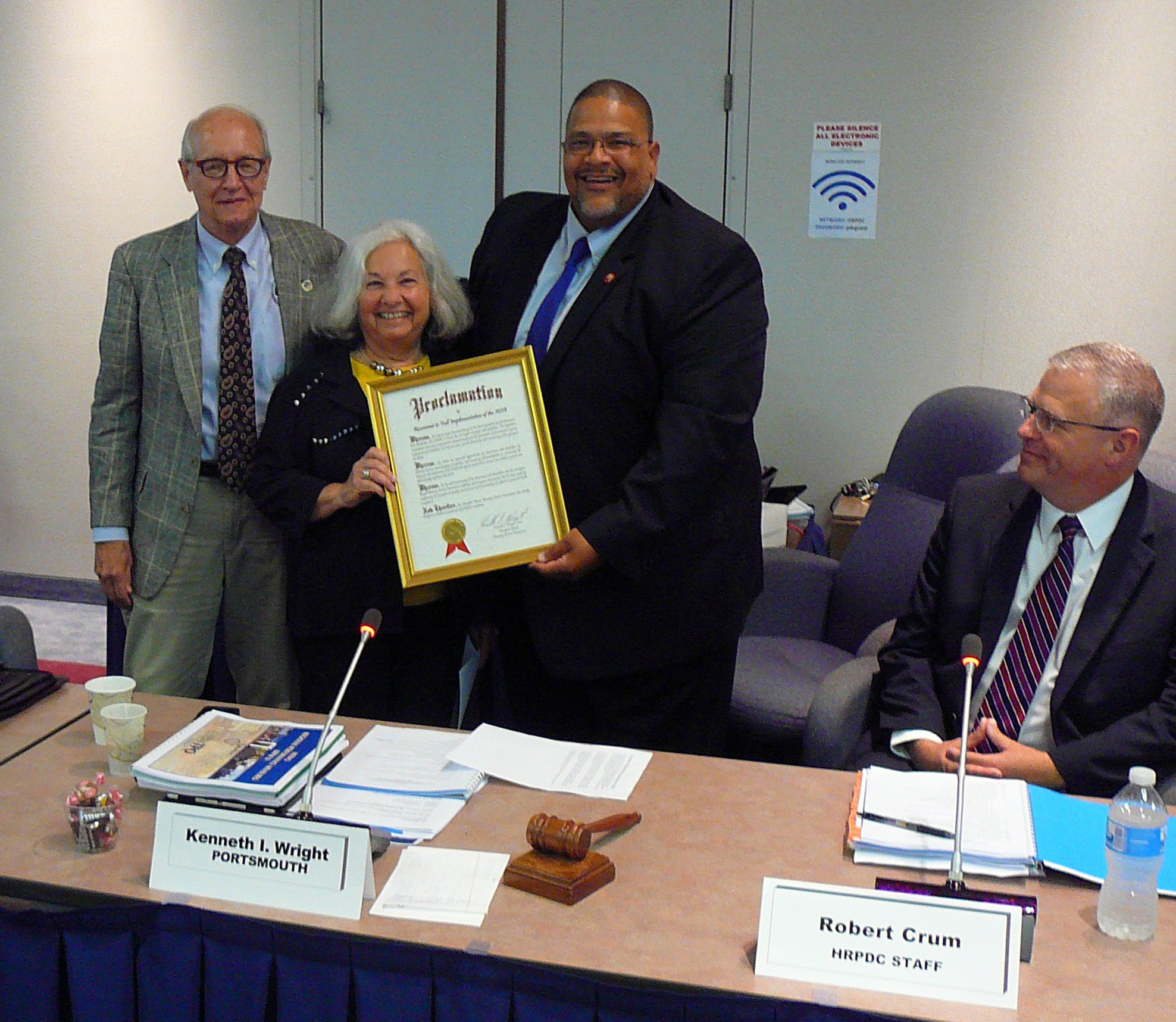 HRDB Chair, Shirley Confino-Rehder accepted the proclamation from HRPDC Chair Kenneth Wright and Vice-Chair Clyde Haulman as HRPDC Executive Director Robert Crum looks on.
