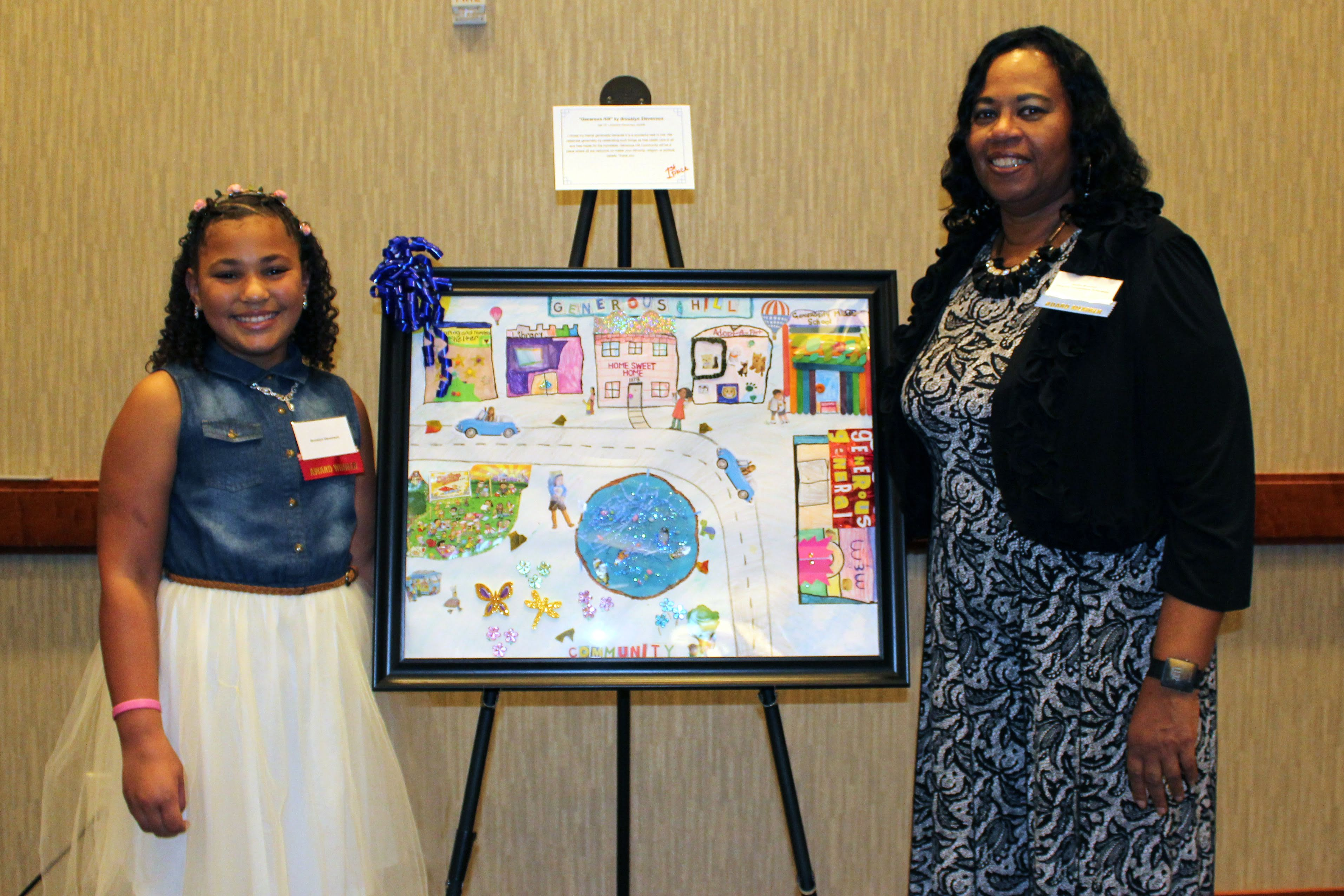 Photo of Brooklyn Stevenson, winner of this year's HRHC Children's Poster Contest, with HRHC Chair, Karen Munden