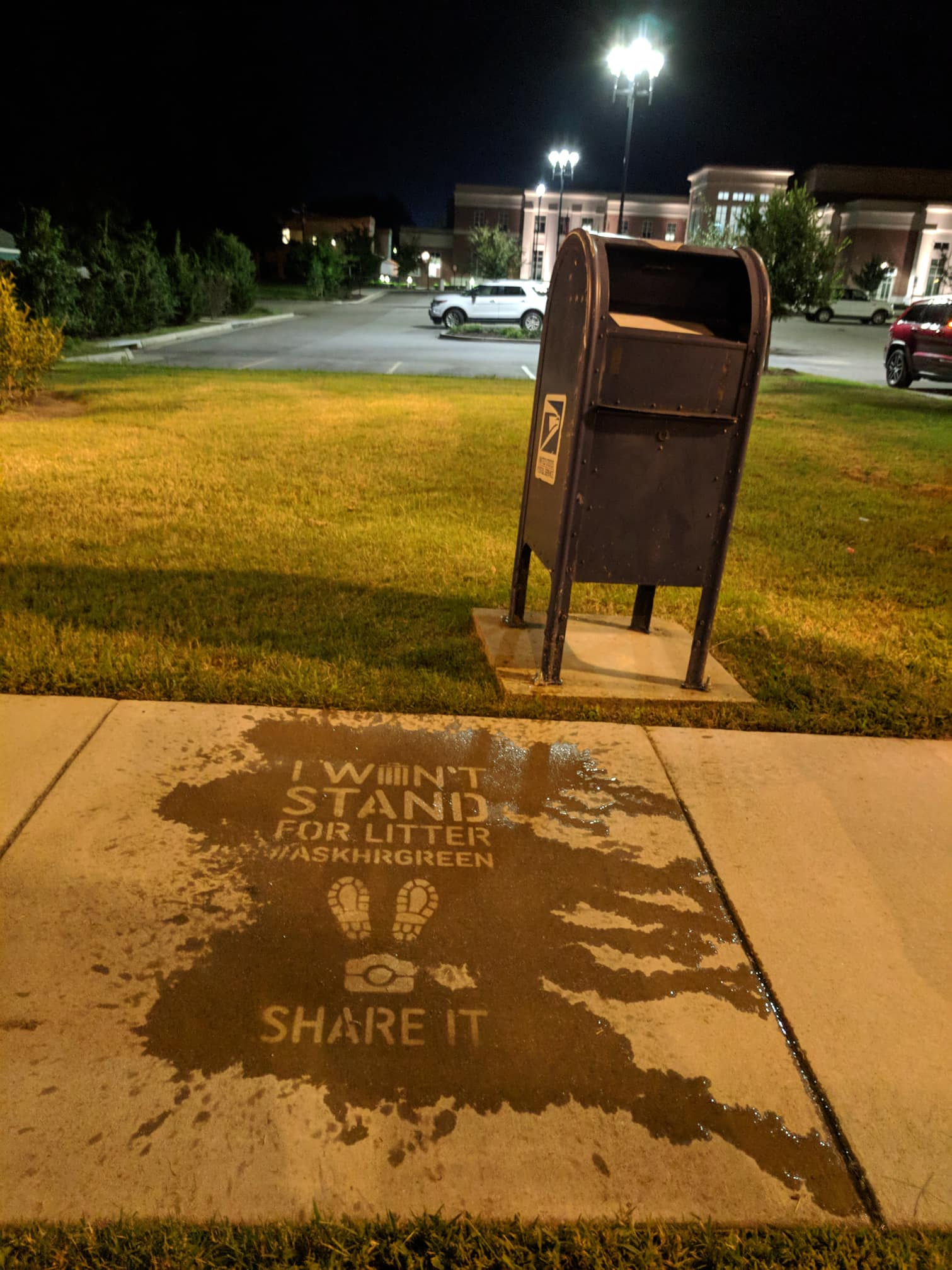 "Another example of a Hidden Message, nighttime photo - ""I won't stand for Litter"""