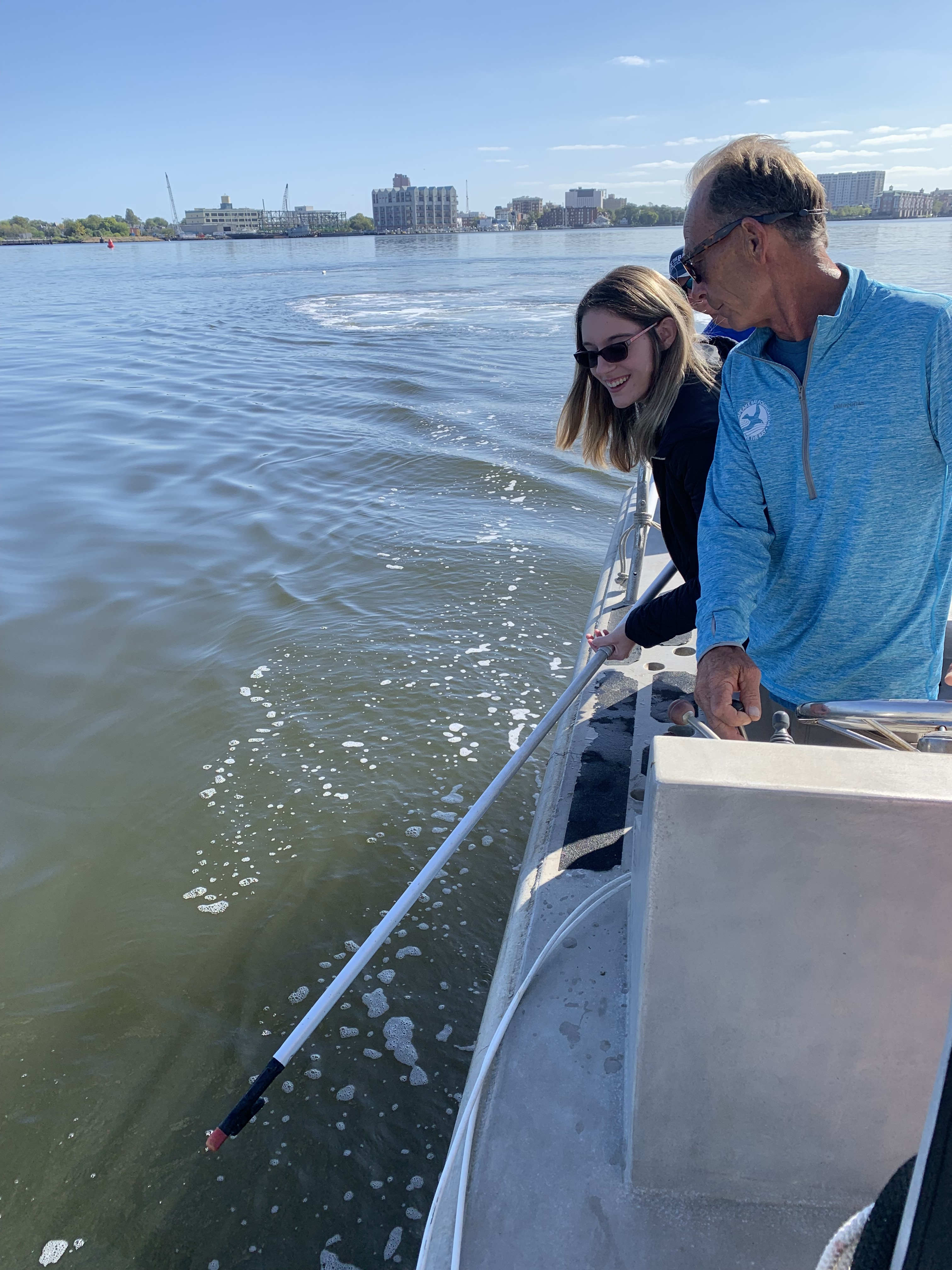 Ms. Danielle Spach hooks a crab pot while Mr. Jimmy Sollner provides instructions.