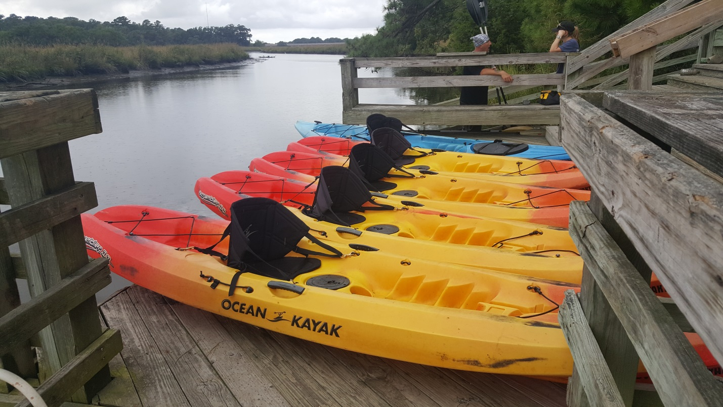 Kayaks on a dock waiting to be launched.