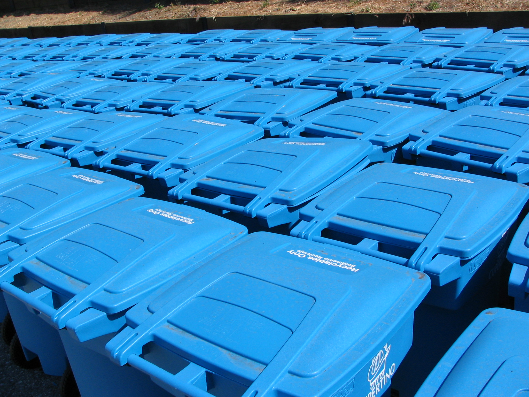 Group of Blue Recycling Containers